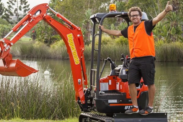 Guy on a Mini Excavator from Diggermate
